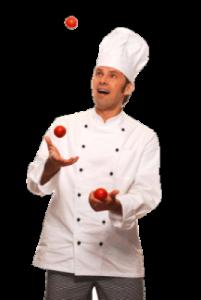 Mit Tomaten jonglierender Koch